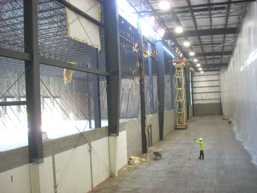 Demolition-of-exterior-wall-and-tie-in-to-new-structure_853x640
